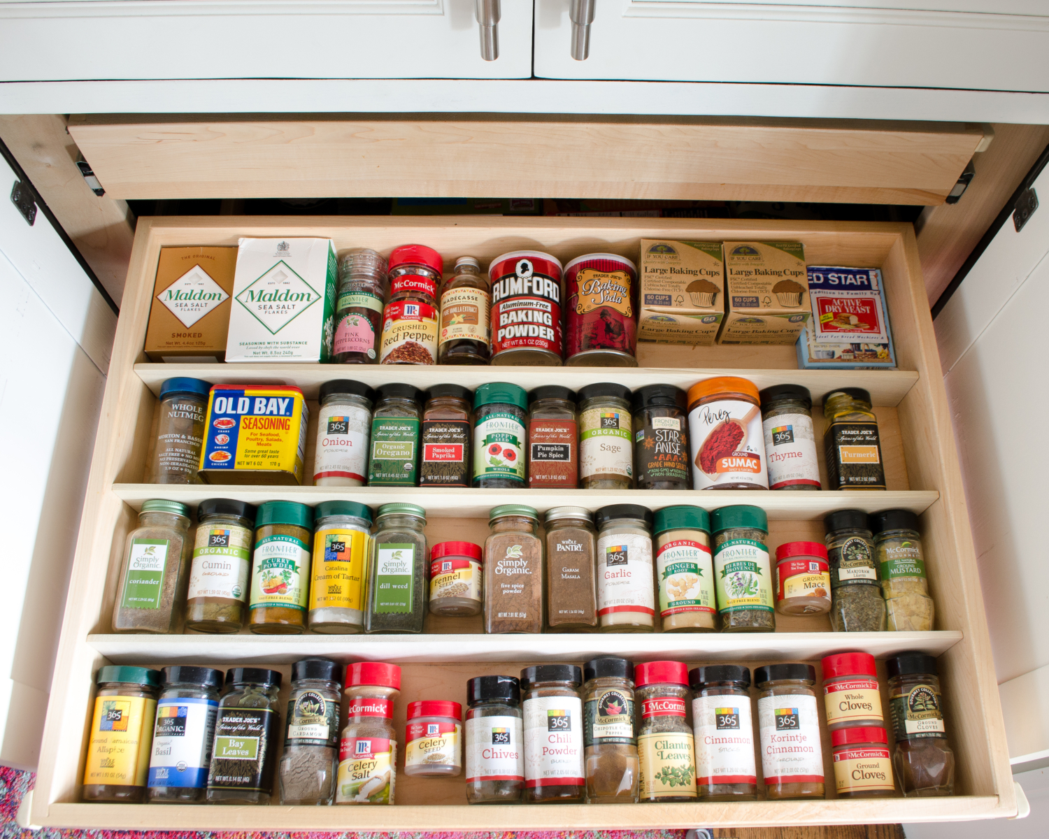 Affordable and easy kitchen organization ideas including how to organize spice jars.