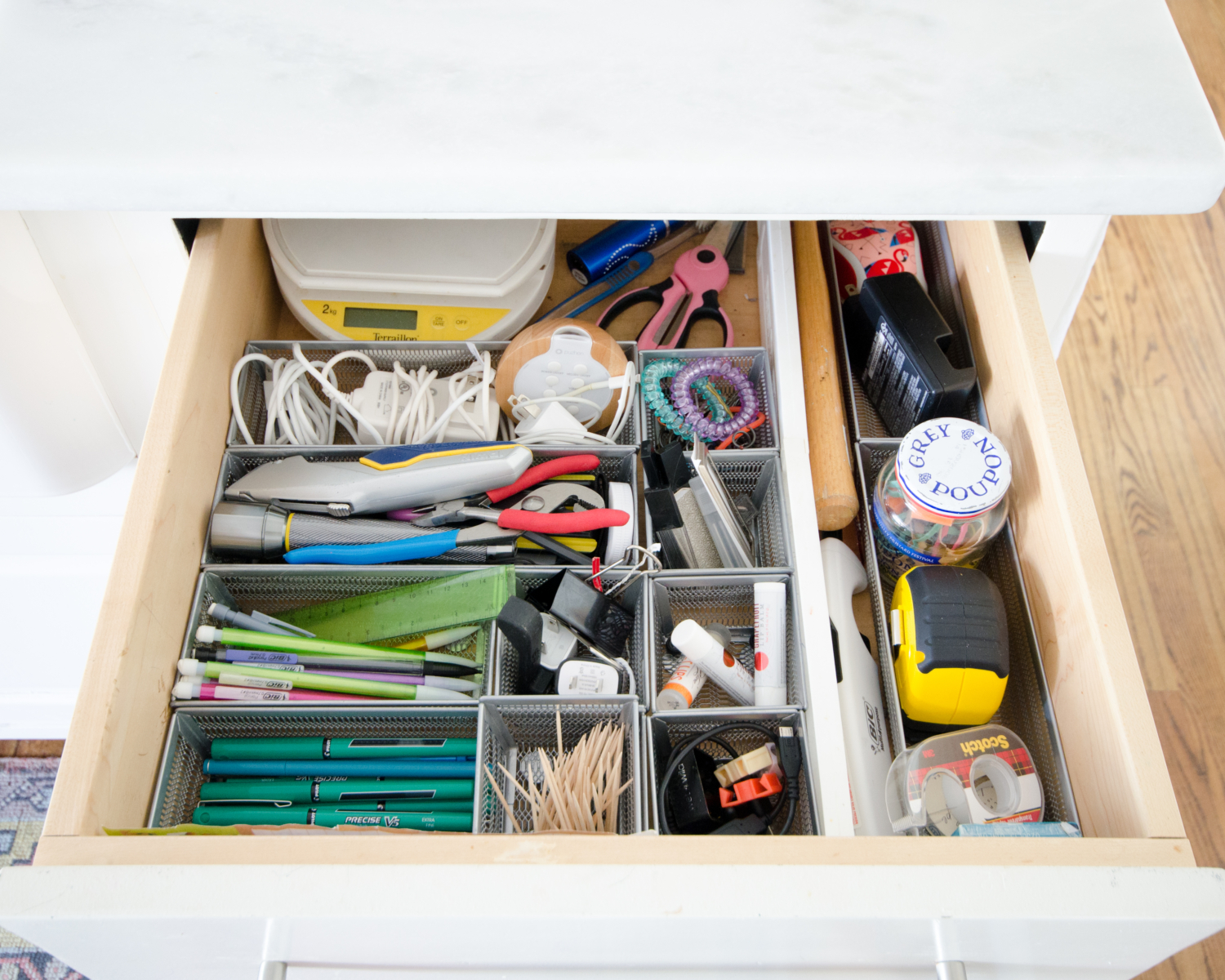 Affordable and easy kitchen organization ideas including how to organize the junk drawer.