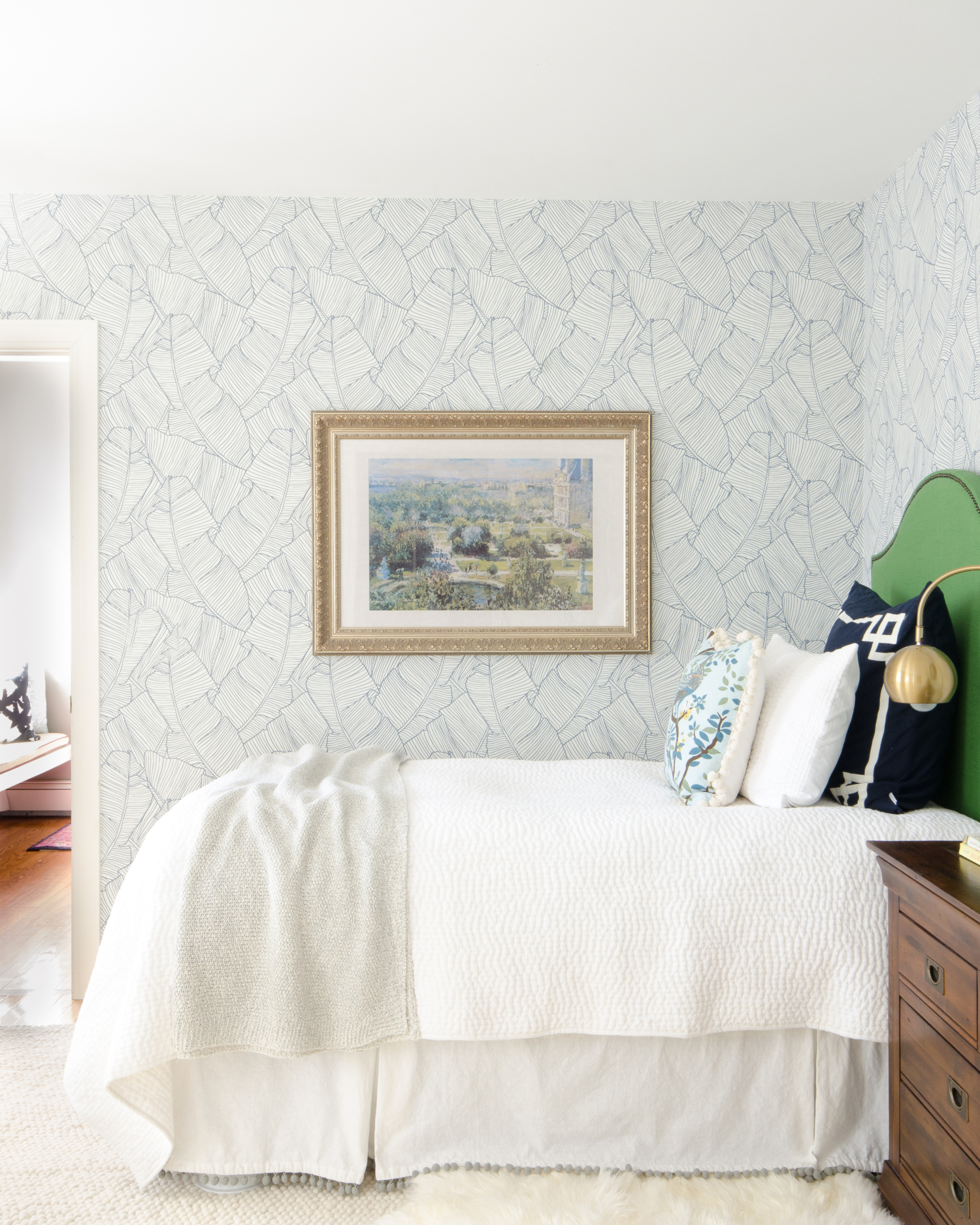 A traditional blue, green, and white bedroom with modern touches. Shows how to create a simple, pretty, and comfortable guest room on a budget!