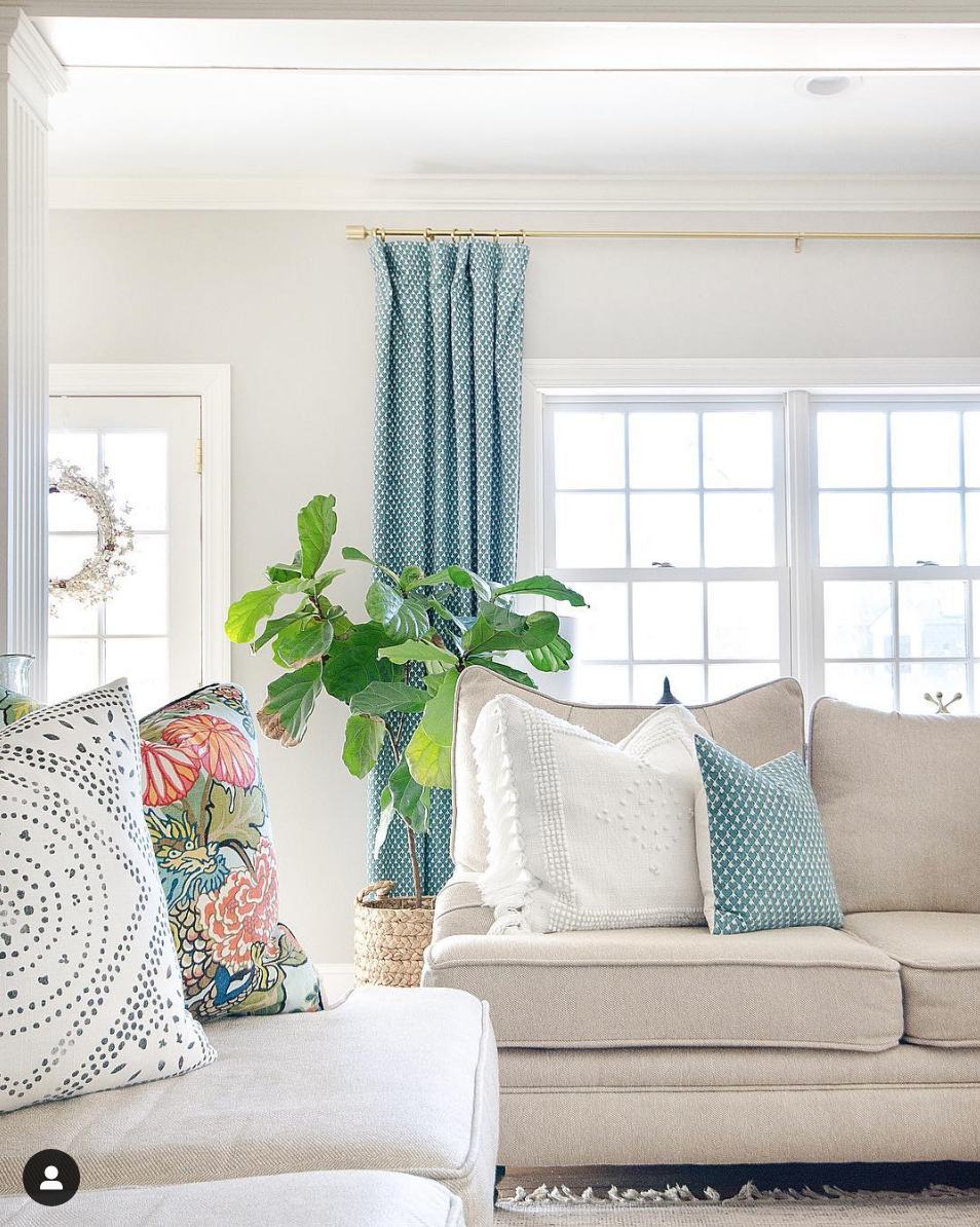 Classic family room that blends neutral and colorful beautifully. Pops of tea; brighten up the beiges and whites.