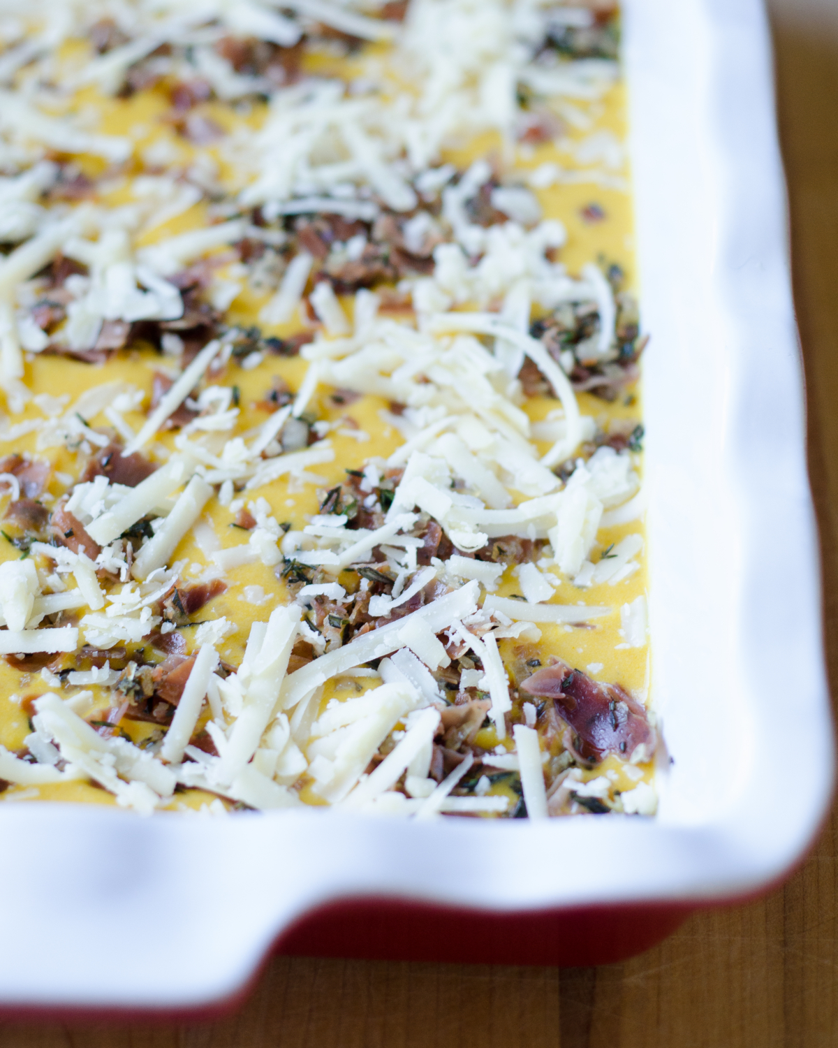 Savory pumpkin lasagna recipe featuring easy canned pumpkin, prosciutto, Gruyere cheese, rosemary, and thyme. Great make ahead recipe for a crowd but easy enough for a weeknight.