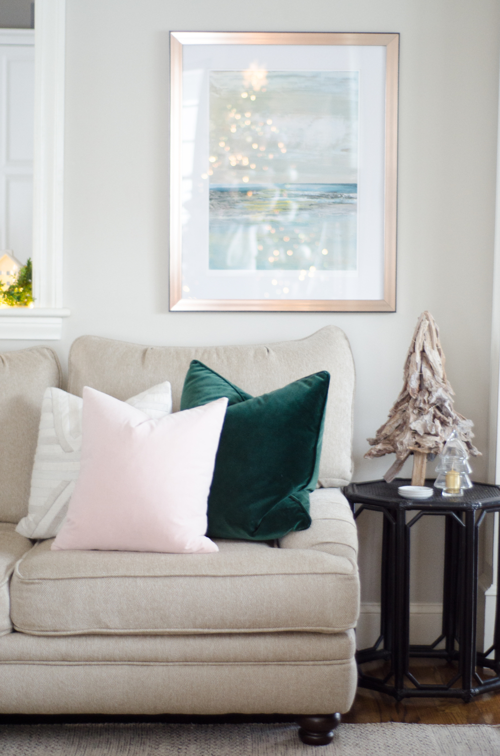 Understated, sophisticated Christmas color palette of beige, white, blush pink, and hunter green.