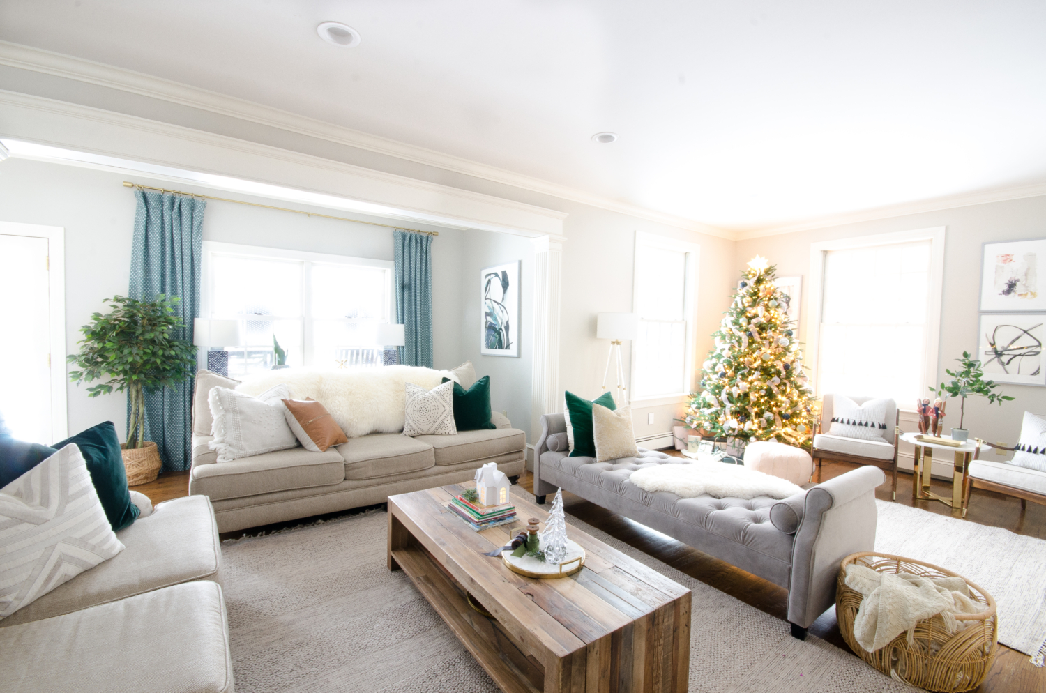 Christmas family room in beige, white, grey velvet, green velvet, and blush pink. Understated and cozy decorating ideas.